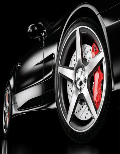 Full mobile auto detailing service on black sportscar with cleanly polished rims and tires